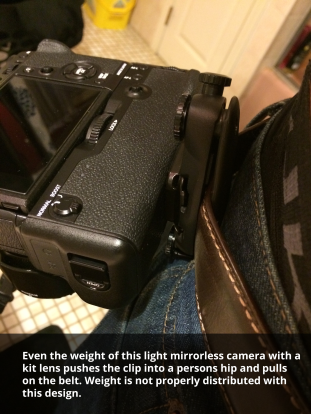 The peak design capture camera clip sitting on a belt